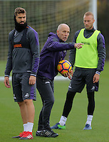 Bob Bradley (C) gives instructions to his players during the Swansea City Training at The Fairwood Training Ground, Wales, UK. Wednesday 16 November 2016
