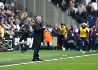 23rd November 2019; London Stadium, London, England; English Premier League Football, West Ham United versus Tottenham Hotspur; Tottenham Hotspur Manager Jose Mourinho pointing to his watch from the touchline  - Strictly Editorial Use Only. No use with unauthorized audio, video, data, fixture lists, club/league logos or 'live' services. Online in-match use limited to 120 images, no video emulation. No use in betting, games or single club/league/player publications