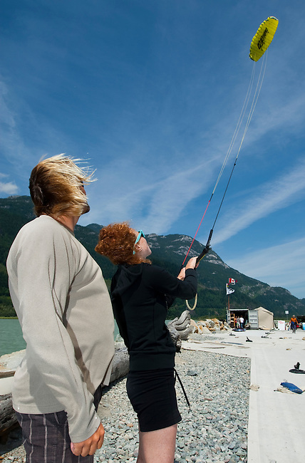 July 15th 2009.  Patrick Herb, IKO-certified Kite boarding Instructor (left), teaches Heather (right), first- time student of kiteboarding, the basics of flying the kite. This kite is made specifically for training.  Photo by Gus Curtis