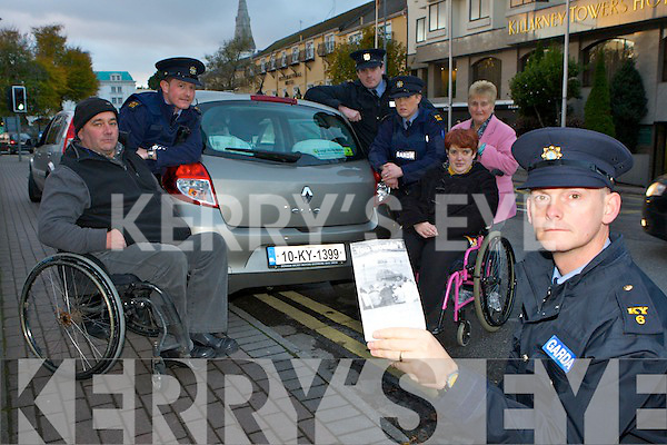 Sargent Dermot O'Connell who are advising people that their will be a clamp down on illegal parking on footpaths in Killarney which is hendering wheelchair users from using the footpaths  l-r: Tim O'Sullivan, Garda Trevor Ryan, Garda Nigel Shevlin, Garda Gillian MacEoin,  Bridget O'Gorman and Nora O'Sullivan