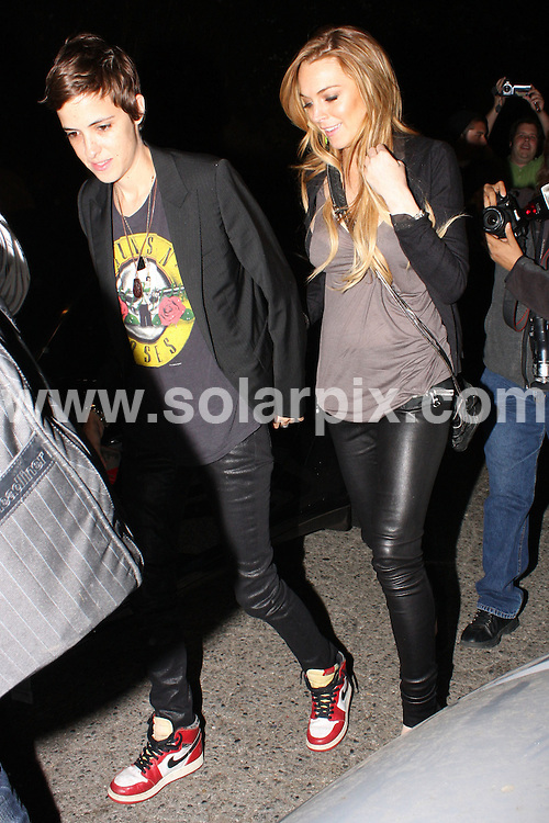**ALL ROUND PICTURES FROM SOLARPIX.COM**.**WORLDWIDE SYNDICATION RIGHTS**.**NO PUBLICATION IN AUSTRALIA, NEW ZEALAND, DENMARK, GERMANY OR USA**.Lindsay Lohan and her girlfriend Samantha Ronson party all night long at The Roxy in West Hollywood Los Angeles California in the USA...JOB REF:7417-LAP/HJSM       DATE:19_09_08 .**MUST CREDIT SOLARPIX.COM OR DOUBLE FEE WILL BE CHARGED* *UNDER NO CIRCUMSTANCES IS THIS IMAGE TO BE REPRODUCED FOR ANY ONLINE EDITION WITHOUT PRIOR PERMISSION*