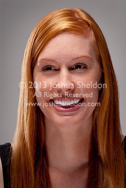 Young red haired woman smiling