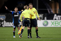 The referee's assistant recounts the play with referee Alex Prus ahead of San Jose Earthquakes midfielder Anthony Ampaipitakwong (23). The San Jose Earthquakes defeated the Houston Dynamo 2-0 at Buck Shaw Stadium in Santa Clara, California on June 4th, 2011.