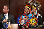 Lt. Gov. Mark Hutchison, left, John D. Rupert, 13, and his father Ben Rupert lead the Senate in the Pledge of Alliegence as part of Nevada Tribes Day at the Legislative Building in Carson City, Nev., on Tuesday, Feb. 10, 2015.   <br /> Photo by Cathleen Allison
