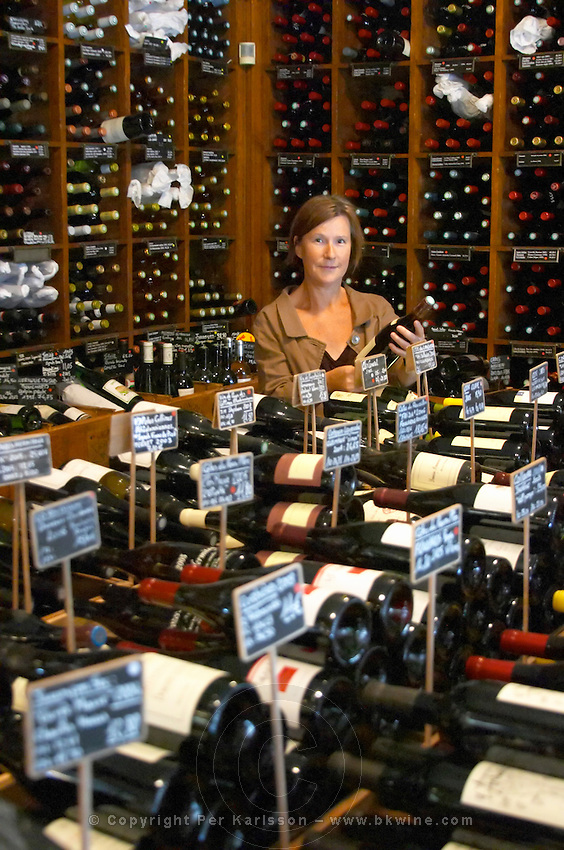 Britt Karlsson, BKWine, in Paris Cave Auge wine shop Paris, France. Wine shop.