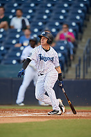 Tampa Tarpons second baseman Diego Castillo (19) follows through on a swing during a game against the Daytona Tortugas on April 18, 2018 at George M. Steinbrenner Field in Tampa, Florida.  Tampa defeated Daytona 12-0.  (Mike Janes/Four Seam Images)
