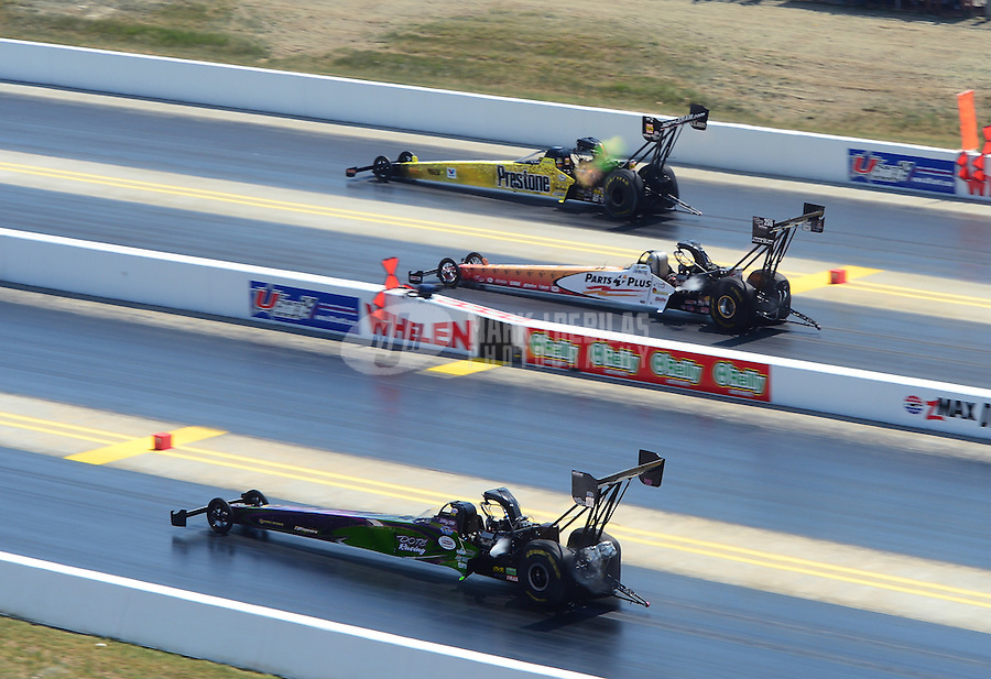 Apr. 14, 2012; Concord, NC, USA: NHRA top fuel dragster drivers (top to bottom) Spencer Massey , Clay Millican and Hillary Will race three wide during qualifying for the Four Wide Nationals at zMax Dragway. Mandatory Credit: Mark J. Rebilas-