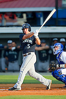 Joseph DeCarlo (5) of the Pulaski Mariners follows through on his swing against the Burlington Royals at Burlington Athletic Park on June20 2013 in Burlington, North Carolina.  The Royals defeated the Mariners 2-1 in 13 innings.  (Brian Westerholt/Four Seam Images)