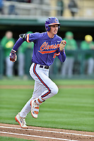 Clemson Tigers shortstop Logan Davidson (8) runs to first base during a game against the Notre Dame Fighting Irish at Doug Kingsmore Stadium on March 11, 2017 in Clemson, South Carolina. The Tigers defeated the Fighting Irish 6-5. (Tony Farlow/Four Seam Images)