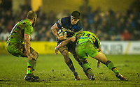 Bath Rugby's Josh Bayliss evades the tackle of Northampton Saints' Nafi Tuitavake<br /> <br /> Photographer Bob Bradford/CameraSport<br /> <br /> Anglo-Welsh Cup Semi Final - Bath Rugby v  Northampton Saints - Friday 9th March 2018 - The Recreation Ground - Bath<br /> <br /> World Copyright &copy; 2018 CameraSport. All rights reserved. 43 Linden Ave. Countesthorpe. Leicester. England. LE8 5PG - Tel: +44 (0) 116 277 4147 - admin@camerasport.com - www.camerasport.com