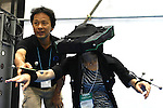 June 24, 2010 - Tokyo, Japan - A visitor tries out the Virtual-Eye HEWDD-1080, which allow the user to perceive virtual worlds, at the 3D and Virtual Reality Expo in Tokyo, Japan, on June 24, 2010. The Japan's largest 3D and virtual reality expo runs from June 23-25 and gives to nearly 1'680 companies to showcase in Tokyo Big Sight 3D cameras and monitors, robots, software, sound systems, scanners, simulators and other products related to 3D and virtual reality.