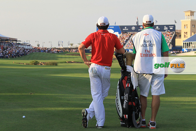 Rory McIlroy (NIR) and caddy J.P.Fitzgerald wait to play his 2nd shot on the 18th hole during Sunday's Final Round of the season ending DP World Tour Championship 2012 held on the Earth Course at the Jumeirah Golf Estates,Dubai. 25th November 2012 (Photo Eoin Clarke/www.golffile.ie)