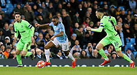 Manchester City's Raheem Sterling under pressure from FC Schalke 04&rsquo;s Nabil Bentaleb<br /> <br /> Photographer Rich Linley/CameraSport<br /> <br /> UEFA Champions League Round of 16 Second Leg - Manchester City v FC Schalke 04 - Tuesday 12th March 2019 - The Etihad - Manchester<br />  <br /> World Copyright &copy; 2018 CameraSport. All rights reserved. 43 Linden Ave. Countesthorpe. Leicester. England. LE8 5PG - Tel: +44 (0) 116 277 4147 - admin@camerasport.com - www.camerasport.com