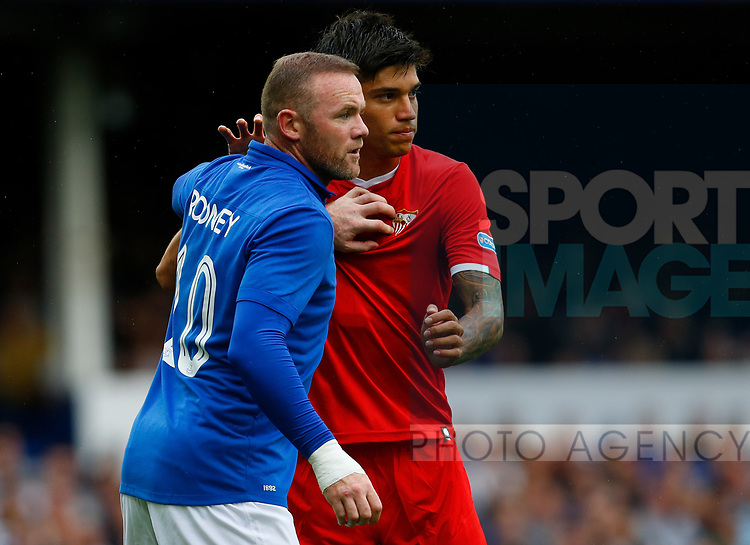 Everton's Wayne Rooney (L) in action with Sevilla's Joaquin Correa during the pre season friendly match at Goodison Park Stadium, Liverpool. Picture date 6th August 2017. Picture credit should read: Paul Thomas/Sportimage