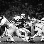 Bosco-Michigan<br /> <br /> 6 Robbie Bosco. Holiday Bowl vs Michigan<br /> <br /> December 21, 1984<br /> <br /> Photo by Mark Philbrick/BYU<br /> <br /> &copy; BYU PHOTO 2009<br /> All Rights Reserved<br /> photo@byu.edu  (801)422-7322