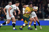Tolu Latu of Australia is tackled by Henry Slade of England. Quilter International match between England and Australia on November 24, 2018 at Twickenham Stadium in London, England. Photo by: Patrick Khachfe / Onside Images
