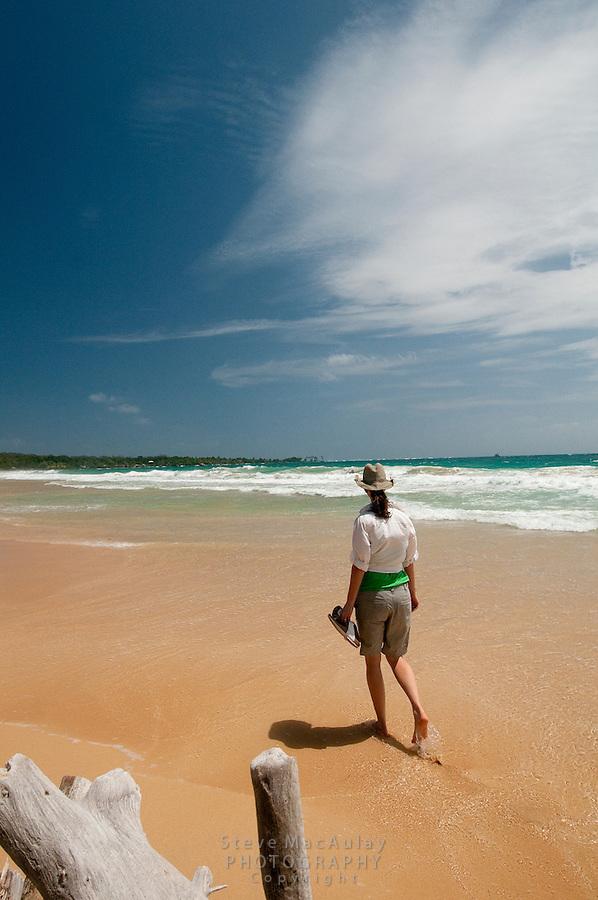Woman playing in the waves, Big Corn Island, Nicaragua