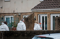 Wednesday 07 May 2014<br /> Pictured: Forensic Officers at Salisbury Road, Newport<br /> Re: Gwent police received a call from the ambulance service to a house on Salisbury Close, Newport this morning at about 8am.<br />  <br /> Two children, a 7 year old boy and a 16 month old baby girl, suffered injuries and are currently at the Royal Gwent Hospital receiving treatment.<br />  <br /> A 27 year old woman, from the Newport area, has been arrested on suspicion of attempted murder and has been taken to the Royal Gwent Hospital where she is receiving treatment for injuries.<br />  <br /> A knife has been recovered from the scene.