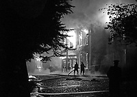 Fireman in action at the scene of the Provisional IRA bombing and subsequent fire at the Woodburn House Hotel on the Stewartstown Road, Belfast, N Ireland, UK, 1971. PLEASE CONTACT ME IF YOU CAN TELL ME EXACT DATE OF INCIDENT. 197100000445a<br />