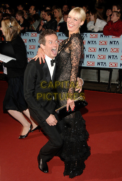 MATTHEW WRIGHT & GUEST.The National Television Awards 2006 held at the Royal Albert Hall, London, UK. - Arrivals.October 31st, 2006.Ref: PL.full length black suit dress lace funny crouching.www.capitalpictures.com.sales@capitalpictures.com.©Phil Loftus/Capital Pictures