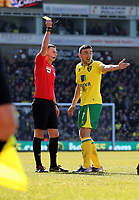 Pictured L-R: Match referee M Oliver shows Robert Snodgrass of Norwich a yellow card after he fouled Dwight Tiendalli of Swansea (not pictured). Saturday 06 April 2013<br />