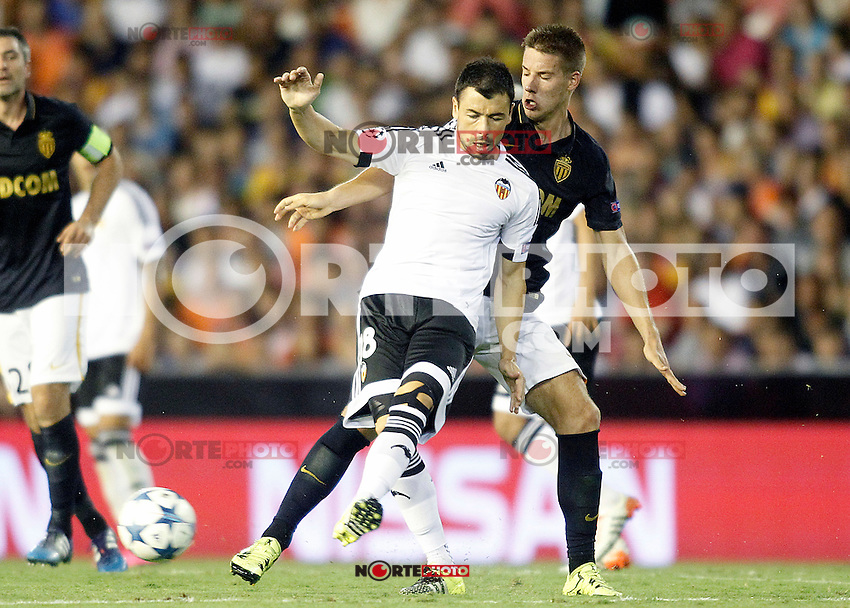 Valencia's Javi Fuego (l) and AS Monaco FC's Mario Pasalic during Champions League 2015/2016 Play-Offs 1st leg match. August  19,2015. (ALTERPHOTOS/Acero)
