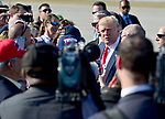 WEST PALM BEACH, FL - FEBRUARY 17: U.S. President Donald J. Trump shake hand and sign autograph for supporters after arrives on Air Force One at the Palm Beach International airport as they prepare to spend part of the weekend at Mar-a-Lago resort on February 17, 2017 in West Palm Beach, Florida. After touring and meeting with Dennis Muilenburg Chairman of the Board, President, and CEO of the Boeing Company in North Charleston, South Carolina.  President Trump schedule to hold a campaign rally tomorrow at Melbourne Florida. ( Photo by Johnny Louis / jlnphotography.com )