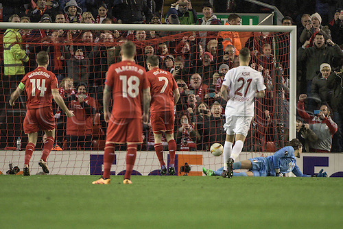25.02.2016. Liverpool, England. UEFA Europa League game between Liverpool FC and Augsburg.  Keeper Marvin Hitz ( FC Augsburg ) is beaten by the penalty from Milner as captain Jordan Henderson (Liverpool FC) celebrates 1-0