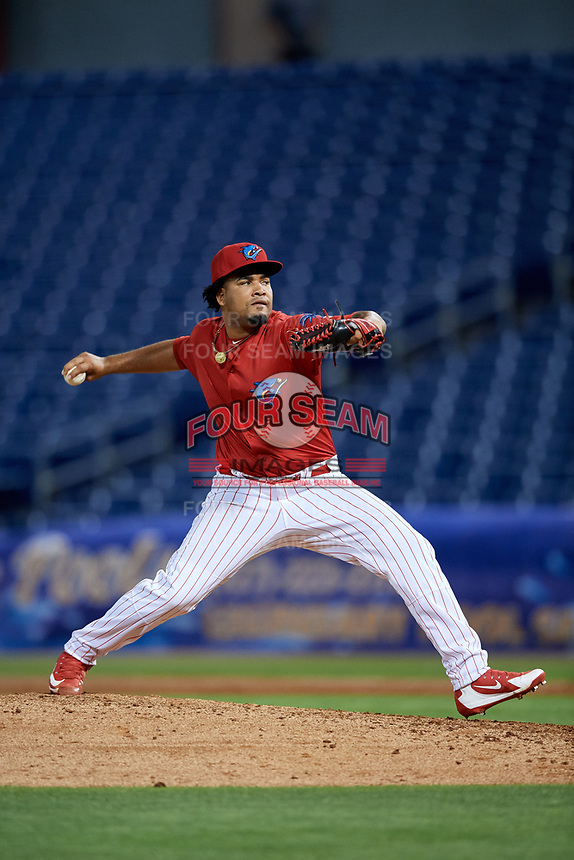 Clearwater Threshers relief pitcher Ismael Cabrera (19) delivers a pitch during a game against the Jupiter Hammerheads on April 12, 2018 at Spectrum Field in Clearwater, Florida.  Jupiter defeated Clearwater 8-4.  (Mike Janes/Four Seam Images)