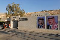 JORDAN, UNESCO world heritage archaeological site Petra, originally known as Raqmu to the Nabataeans / JORDANIEN, historische Nabataeer Stadt Petra, Bildnis rechts gegenwaertiger Koenig Abdullah II. bin al-Hussein, links sein Vater Hussein 1935-1999