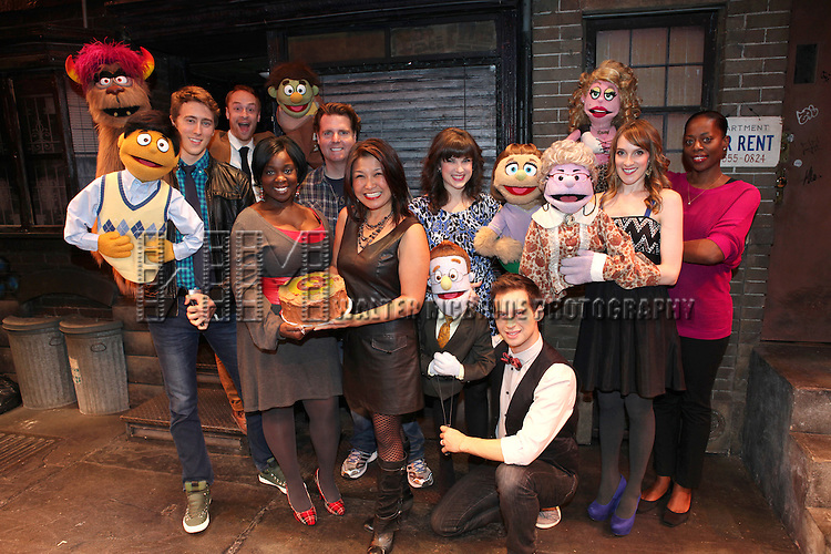 The cast of 'Avenue Q' (L to R) Darren Bluestone (Princeton), Rob Morrison (Trekkie), Danielle K. Thomas, Nicholas Kohn, Hazel Anne Raymundo, Veronica Kuehn (Kate Monster), Jed Resnick (Rod), Lexy Fridell (Mrs. T), Robin S. Walker (Lucy) celebrating their 3rd Anniversary Off-Broadway at The World Stages on 10/22/2012 in New York City.
