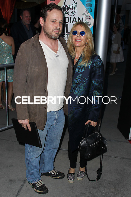 "HOLLYWOOD, LOS ANGELES, CA, USA - APRIL 08: Richmond Arquette, Rosanna Arquette at the Indian Film Festival Of Los Angeles 2014 - Opening Night Screening Of ""Sold"" held at ArcLight Cinemas on April 8, 2014 in Hollywood, Los Angeles, California, United States. (Photo by Xavier Collin/Celebrity Monitor)"