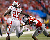 Ohio State Buckeyes defensive back Vonn Bell (11) makes a tackle on Wisconsin Badgers running back Melvin Gordon (25) during the 1st quarter in the 2014 Big Ten Football Championship Game at Lucas Oil Stadium in Indianapolis, Ind. on December 6, 2014.  (Dispatch photo by Kyle Robertson)