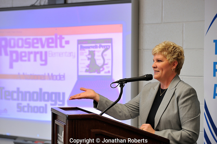 Principal Pam Howell talks during Roosevelt-Perry Elementary School's technology wing opening celebration.