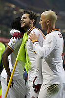 MILAN, Italy: December 16, 2013: AC Milan and As Roma tie 2-2 during the Serie A match played in the San Siro Stadium. In the photo Kouassi Gervinho, Mattia Destro and Michael Bradley celebrating the goal of 1-0