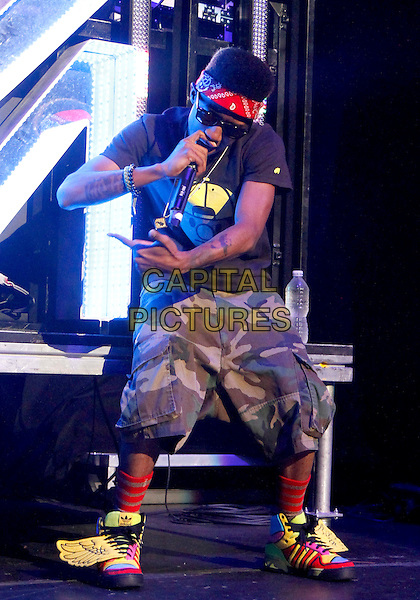 Lil Twist.performing on the #1 Girl Tour at the Fox Theater in downtown Atlanta, GA, USA, .August 4th, 2012..music live on stage performing full length black t-shirt hand arm microphone singing trainers wings shirts camouflage yellow red .CAP/ADM/DH.©Dan Harr/AdMedia/Capital Pictures.
