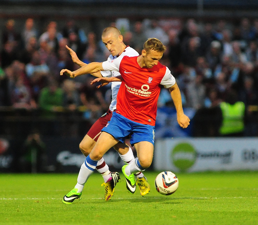 York City's Ryan Jarvis is fouled by Burnley's David Jones <br /> <br /> (Photo by Chris Vaughan/CameraSport<br /> <br /> Football - Capital One Cup First Round - York City v Burnley - Tuesday 6th August 2013 - Bootham Crescent - York<br />  <br /> &copy; CameraSport - 43 Linden Ave. Countesthorpe. Leicester. England. LE8 5PG - Tel: +44 (0) 116 277 4147 - admin@camerasport.com - www.camerasport.com
