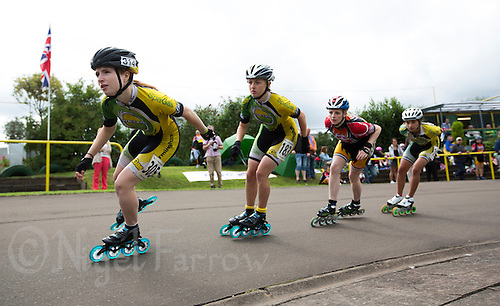 11 AUG 2013 - BIRMINGHAM, GBR - Tiffany James (left) of Birmingham Wheels Roller Speed Club leads the other competitors, BWRSC team mates Kirsty Pullen (second from the left) and Paige Aitken (right) and, Louise Sullivan (second from right) of South Woodham Ferrers Roller Speed Skating Club at the start of a lap during the Junior Girl's 1000m Final at the Federation of Inline Speed Skating 2013 British Outdoor Championships at Birmingham Wheels Park in Birmingham, West Midlands, Great Britain (PHOTO COPYRIGHT © 2013 NIGEL FARROW, ALL RIGHTS RESERVED)