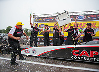 Aug 19, 2018; Brainerd, MN, USA; Crew members for NHRA top fuel driver Billy Torrence celebrates after winning the Lucas Oil Nationals at Brainerd International Raceway. Mandatory Credit: Mark J. Rebilas-USA TODAY Sports