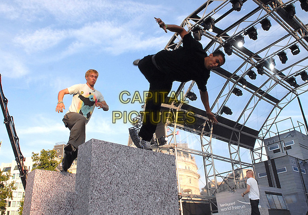 COMPETITORS.The Barclaycard World Free Run Championships, Trafalgar Square, London, England. August 15th, 2009 .full length gesture sport jump jumping in air black t-shirt white jeans freerunning .CAP/IA.©Ian Allis/Capital Pictures.