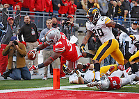Ohio State Buckeyes running back Carlos Hyde (34)dives into the end zone for a fourth quarter TD against Iowa at Ohio Stadium on October 19, 2013.  (Chris Russell/Dispatch Photo)