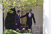 US President Barack Obama and Japan's Prime Minister Shinzo Abe arrive for a joint press conference at The White House in Washington DC for a State Visit, April 28, 2015. Credit: Chris Kleponis / CNP