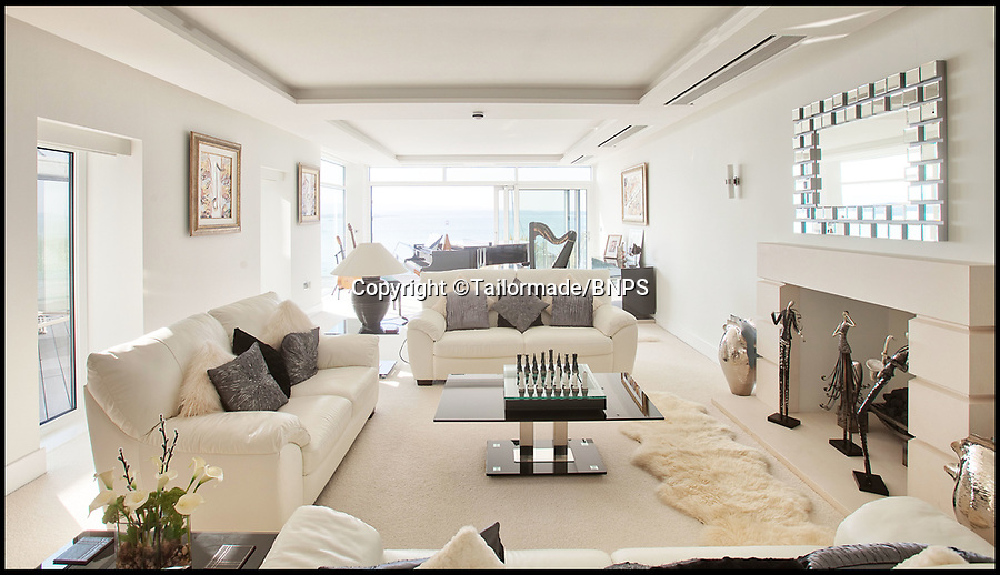 BNPS.co.uk (01202) 558833<br /> Pic: Tailormade/BNPS<br /> <br /> Bit of all white...<br /> <br /> tunning super home for sale - If you've got £9 million to spare...<br /> <br /> This state of the art mega-home is for sale on the exclusive millionaires playground of Sandbanks in Poole, Dorset.<br /> <br /> The biggest, most expensive, and luxurious home ever to come on the market on the tiny peninsula, it is now selling for a cool £8.75m.<br /> <br /> Called The Moorings, the harbour front mansion has stunning sea views, and is on one of the most enviable plots on Millionaire's Row.<br /> <br /> Its owners, entrepreneur Chris Thomas and wife Sue, spent a staggering £5.5m building the palatial home that has been compared to a five star hotel.<br /> <br /> Spread over 13,000 sq ft - the equivalent size of seven detached houses - the state-of-the art property comes with five en suite bedrooms, three reception rooms, an office, cinema room, indoor swimming pool, sauna, gym, gate house and boat house.