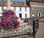 Floral display on war memorial in the town of Fakenham, north Norfolk, England
