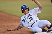 Asheville Tourists second baseman Michael Benjamin #18 slides into third during a game against the Savannah Sand Gnats at McCormick Field July 16, 2014 in Asheville, North Carolina. The Tourists defeated the Sand Gnats 6-3. (Tony Farlow/Four Seam Images)