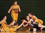 JANUARY 31, 2015 -- Georgia Ohrdorf #12 of Metro State tries to control the ball surrounded by Black Hills State defenders Bailey Kusser #23, Dakota Barrie #32, Cassidy Kotelman #30 and Remi Wientjes #10 during their Rocky Mountain Athletic Conference women's basketball game Saturday evening at the Donald E. Young Center in Spearfish, S.D.  (Photo by Dick Carlson/Inertia)