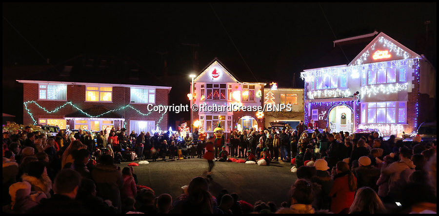 BNPS.co.uk (01202 558833)Pic: RichardCrease/BNPS<br /> <br /> A cul-de-sac dubbed Britain's most festive street has turned on their annual Christmas dazzling display - 25 years after the tradition started as a bit of friendly rivalry between neighbours.<br /> <br /> Nearly all the 50 houses in Runton Road in Poole, Dorset, are lit up at this time of year with flashing bulbs, singing Santas, giant inflatable snowmen and model reindeers, sleighs and trains.<br /> <br /> The dazzling display, which was switched on by Miss Dorset, can be seen from half-a-mile away and the electricity board say the local grid 'takes a bit of a hit' when it is turned on every day at dusk.<br /> <br /> The suburban street was crammed with more than 400 visitors who flocked from all over the country to see the lights.