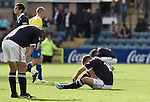 Dundee players slump to the ground at the final whistle of a Scottish League First Division match at Dens Park stadium against visitors Greenock Morton. The visitors won by one goal to nil watched by a crowd of 4,096. Dundee  stadium was situated on the same street as their city rival Dundee United, whose Tannadice Park ground was situated a few hundred yards away.