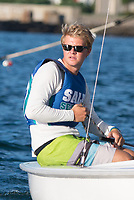 Skipper Sean Beaulieu,'18, lines up for a start as the Salve Regina Sailing Team practices in the Newport Harbor.