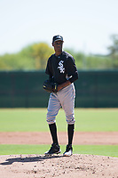 Chicago White Sox relief pitcher Yordi Rosario (59) gets ready to deliver a pitch during an Instructional League game against the Kansas City Royals at Camelback Ranch on September 25, 2018 in Glendale, Arizona. (Zachary Lucy/Four Seam Images)